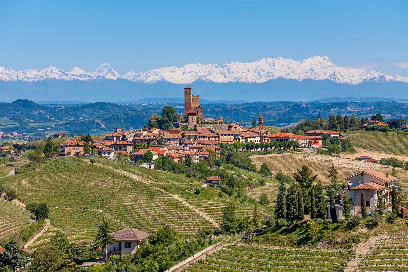 Small town in Piedmont with the view of the Alps in the background